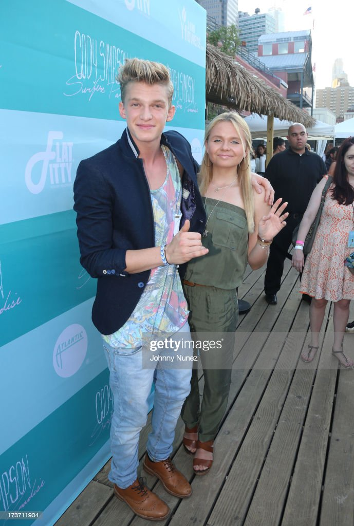 <a gi-track='captionPersonalityLinkClicked' href=/galleries/search?phrase=Cody+Simpson&family=editorial&specificpeople=7068455 ng-click='$event.stopPropagation()'>Cody Simpson</a> and Alli Simpson attend the 'Surfer's Paradise' Album Release Party at Beekman Beer Garden Beach Club on July 16, 2013 in New York City.