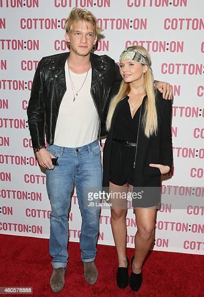 Cody Simpson and Alli Simpson celebrate 'I Give A Brick' Campaign at Cotton On on December 16 2014 in Santa Monica California