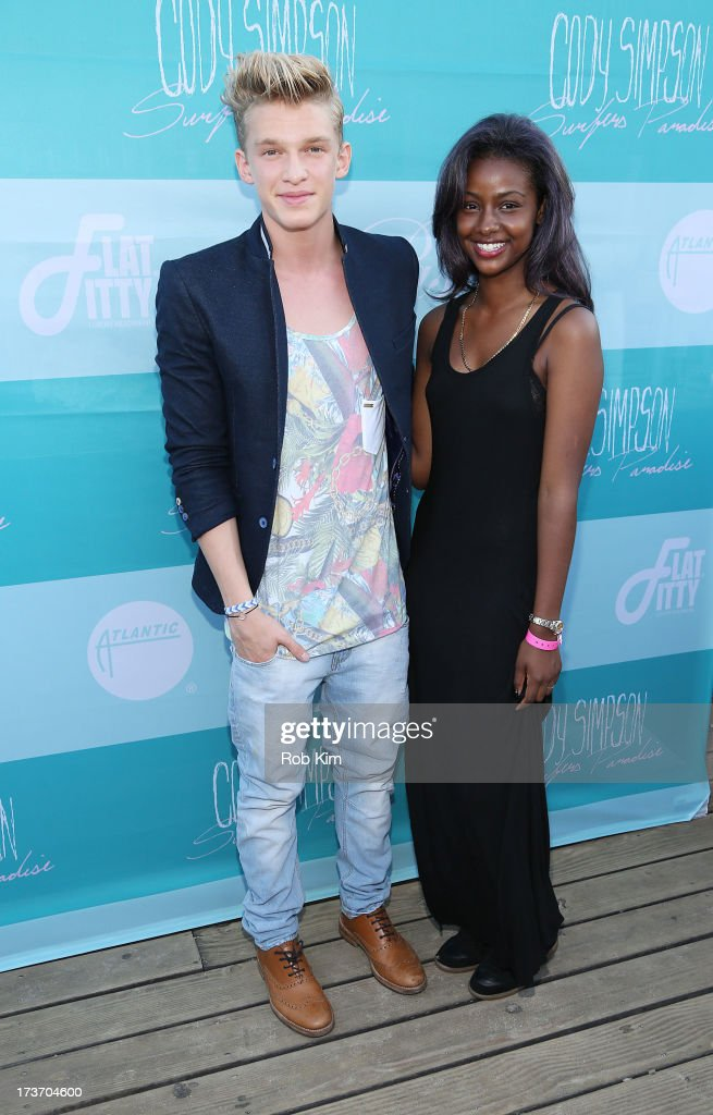 <a gi-track='captionPersonalityLinkClicked' href=/galleries/search?phrase=Cody+Simpson&family=editorial&specificpeople=7068455 ng-click='$event.stopPropagation()'>Cody Simpson</a> and Justine Skye attend the 'Surfer's Paradise' album release party at Beekman Beer Garden Beach Club on July 16, 2013 in New York City.
