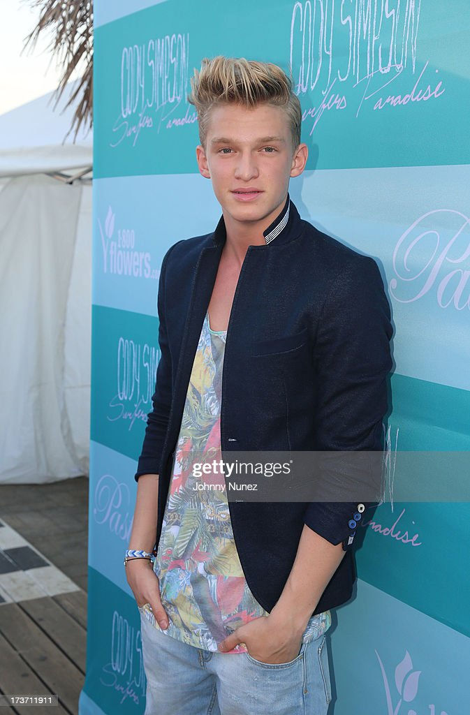 <a gi-track='captionPersonalityLinkClicked' href=/galleries/search?phrase=Cody+Simpson&family=editorial&specificpeople=7068455 ng-click='$event.stopPropagation()'>Cody Simpson</a> attends the 'Surfer's Paradise' Album Release Party at Beekman Beer Garden Beach Club on July 16, 2013 in New York City.
