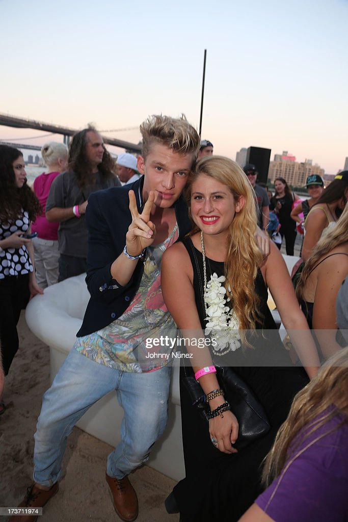 Cody Simpson (L) attends the 'Surfer's Paradise' Album Release Party at Beekman Beer Garden Beach Club on July 16, 2013 in New York City.