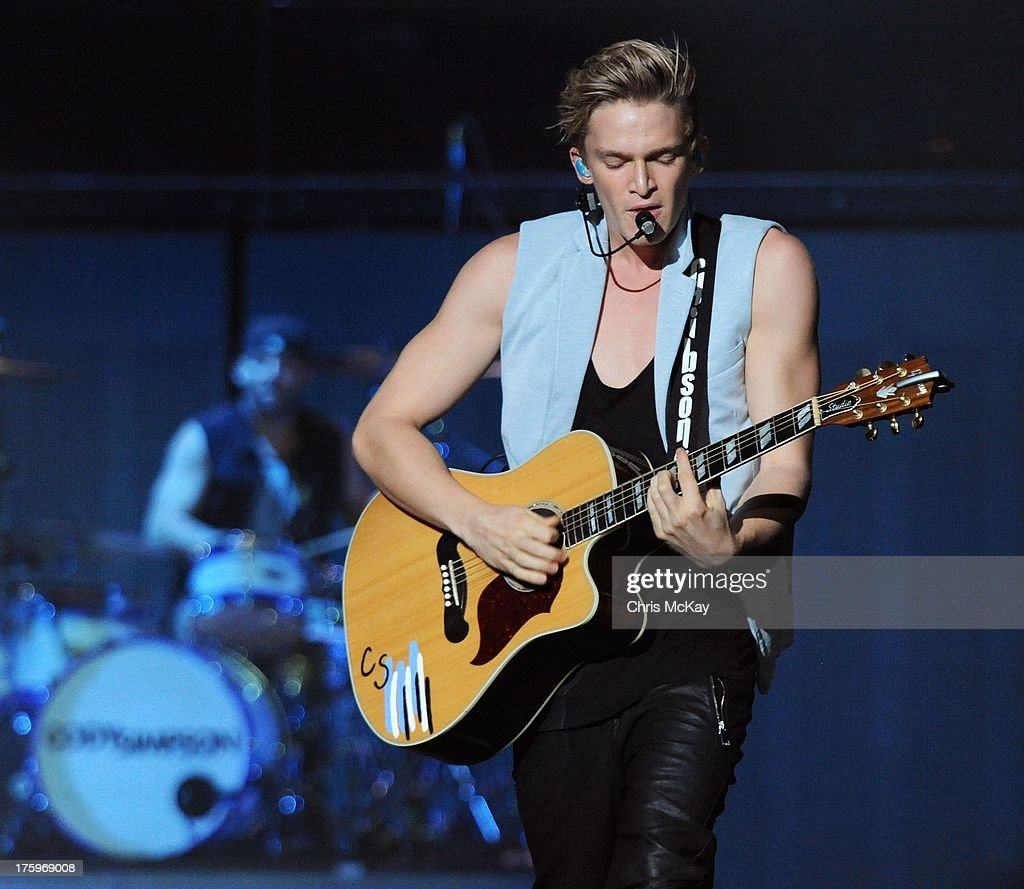 <a gi-track='captionPersonalityLinkClicked' href=/galleries/search?phrase=Cody+Simpson&family=editorial&specificpeople=7068455 ng-click='$event.stopPropagation()'>Cody Simpson</a> performs at Philips Arena on August 10, 2013 in Atlanta, Georgia.