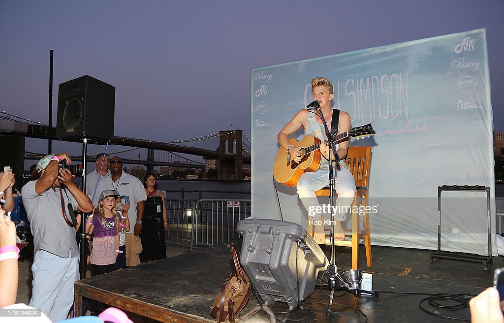 <a gi-track='captionPersonalityLinkClicked' href=/galleries/search?phrase=Cody+Simpson&family=editorial&specificpeople=7068455 ng-click='$event.stopPropagation()'>Cody Simpson</a> performs at the 'Surfer's Paradise' album release party at Beekman Beer Garden Beach Club on July 16, 2013 in New York City.