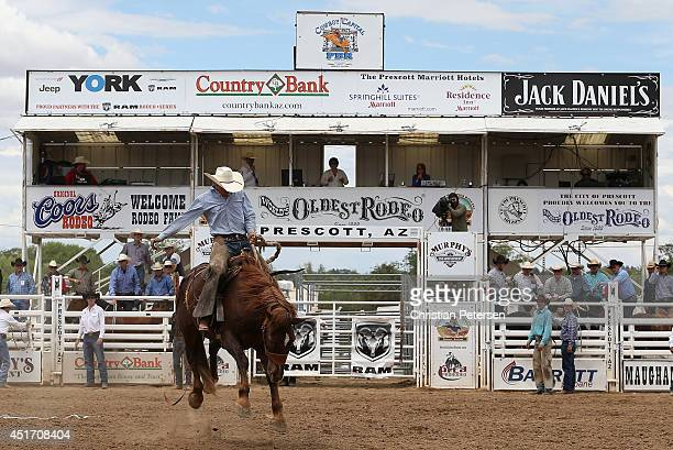 Cody Tillery competes in the Bronc Riding at the Prescott Frontier Days 'World's Oldest Rodeo' on July 4 2014 in Prescott Arizona
