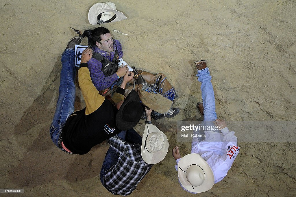 Cody Tyrrell of Tongala receives attention in the Bareback Bronc Riding during the National Rodeo Finals on June 15, 2013 on the Gold Coast, Australia.