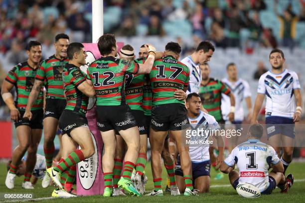 Cody Walker of the Rabbitohs celebrates with his team mates after scoring a try during the round 15 NRL match between the South Sydney Rabbitohs and...