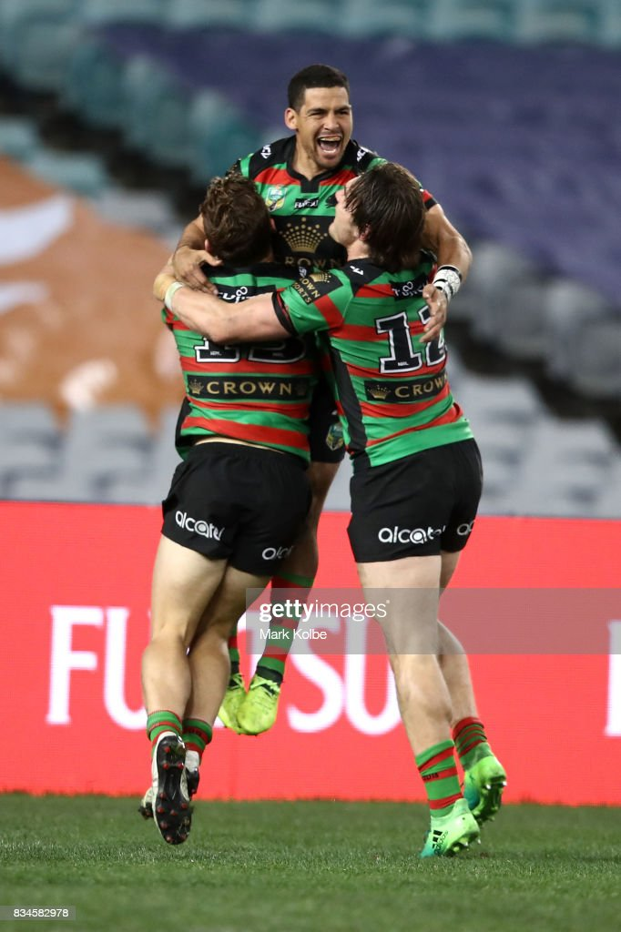 Cody Walker of the Rabbitohs celebrates with his team mates Cameron Murray and Angus Crichton of the Rabbitohs after scoring a try during the round 24 NRL match between the South Sydney Rabbitohs and the New Zealand Warriors at ANZ Stadium on August 18, 2017 in Sydney, Australia.