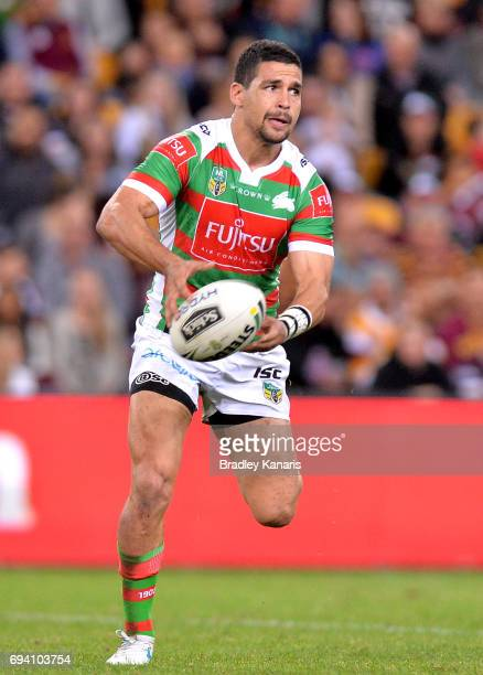 Cody Walker of the Rabbitohs passes the ball during the round 14 NRL match between the Brisbane Broncos and the South Sydney Rabbitohs at Suncorp...