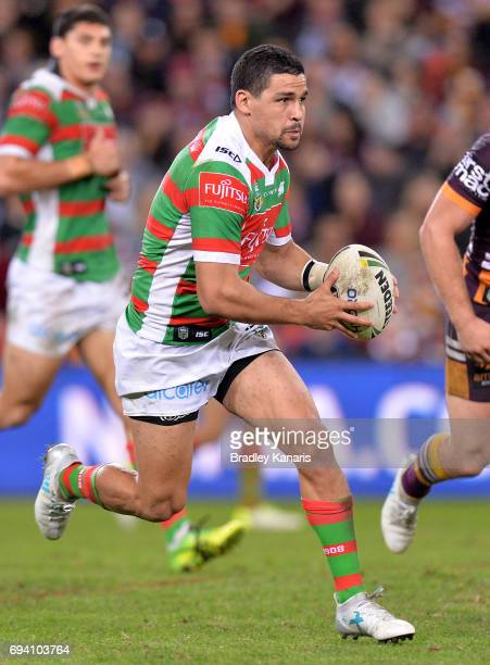 Cody Walker of the Rabbitohs runs with the ball during the round 14 NRL match between the Brisbane Broncos and the South Sydney Rabbitohs at Suncorp...