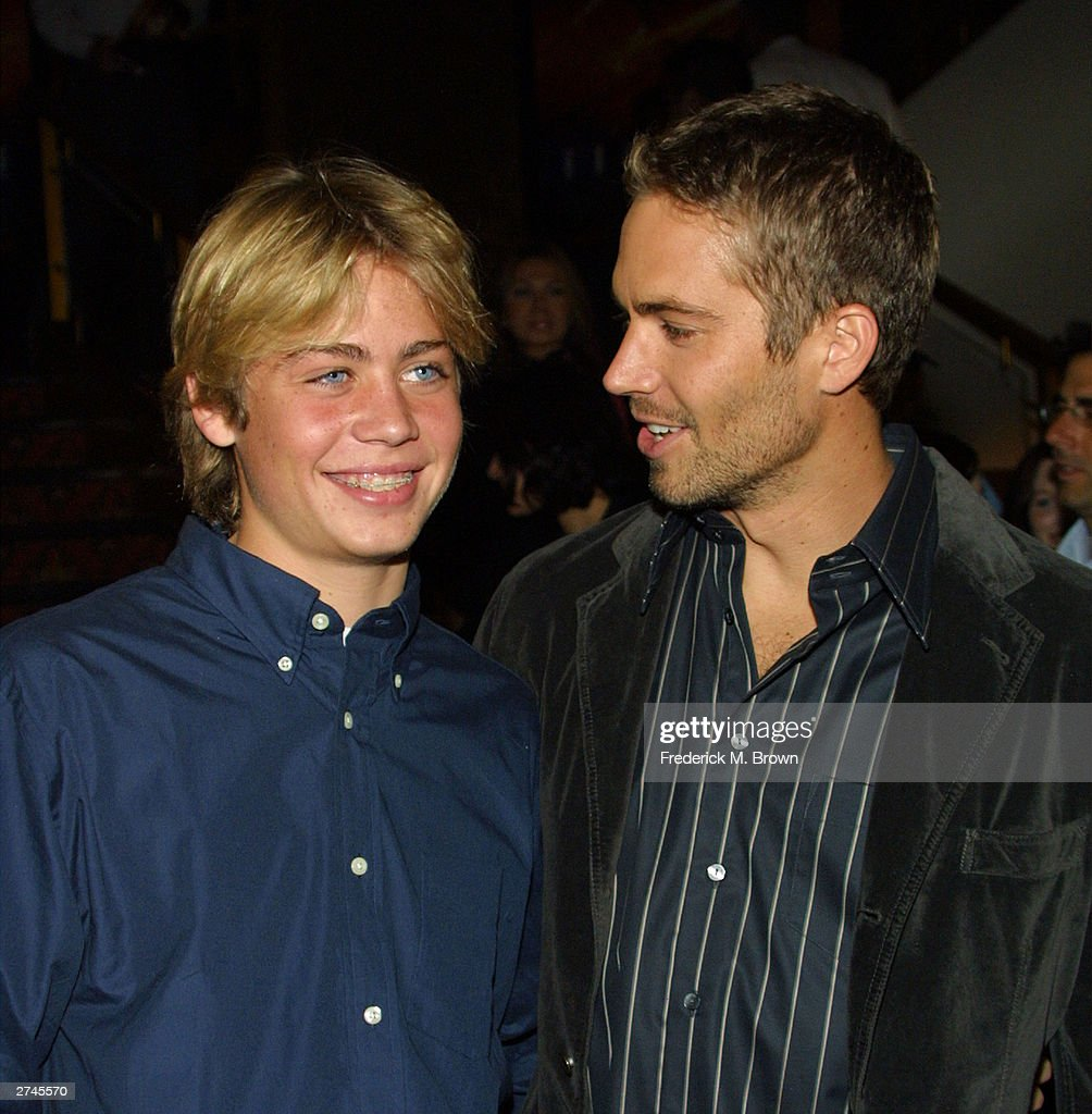 Cody Walker with his brother actor Paul Walker pose during the film premiere of 'Timeline' at the Mann's National Theatre on November 19, 2003 in Westwood, California. The film 'Timeline' will be released on November 26, 2003.