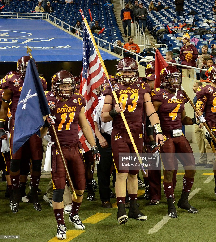 Cody Wilson #11, Joe Kinville #93 and Jahleel Addae #4 of the Central Michigan University Chippewas wait to take the field prior to the Little Caesars Pizza Bowl against the Western Kentucky University Hilltoppers at Ford Field on December 26, 2012 in Detroit, Michigan. The Chippewas defeated the Hilltoppers 24-21.