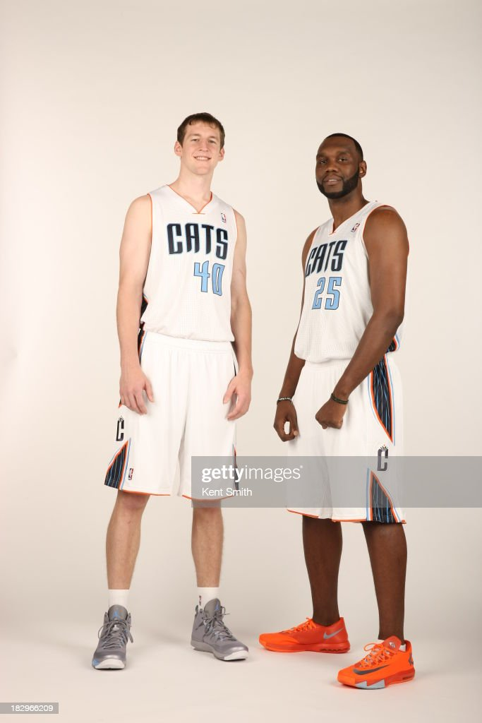 Cody Zeller #40 and Al Jefferson #25 of the Charlotte Bobcats pose for a portrait on media day at the Time Warner Cable Arena on September 30, 2013 in Charlotte, North Carolina.