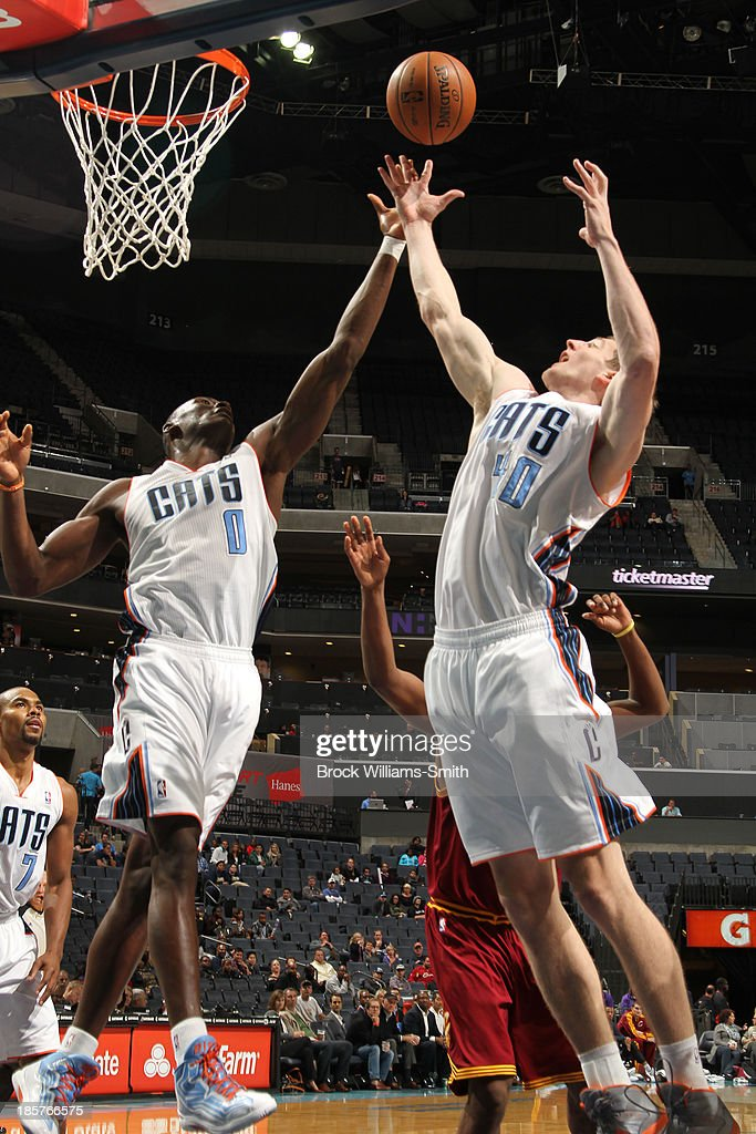 <a gi-track='captionPersonalityLinkClicked' href=/galleries/search?phrase=Cody+Zeller&family=editorial&specificpeople=7621233 ng-click='$event.stopPropagation()'>Cody Zeller</a> #40 and <a gi-track='captionPersonalityLinkClicked' href=/galleries/search?phrase=Bismack+Biyombo&family=editorial&specificpeople=7640443 ng-click='$event.stopPropagation()'>Bismack Biyombo</a> #0 of the Charlotte Bobcats go for the rebound against the Cleveland Cavaliers during the game at the Time Warner Cable Arena on October 24, 2013 in Charlotte, North Carolina.