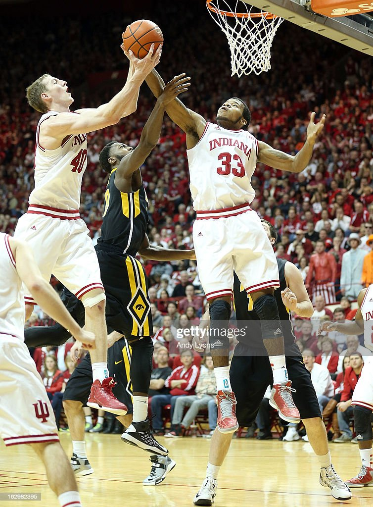 Cody Zeller #40 and Jeremy Hollowell #33 of the Indiana Hoosiers grab for a rebound during the game against the Iowa Hawkeyes at Assembly Hall on March 2, 2013 in Bloomington, Indiana.