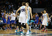 Cody Zeller celebrates with teammate Spencer Hawes of the Charlotte Hornets after hitting the game winning shot to defeat the New York Knicks 9593...