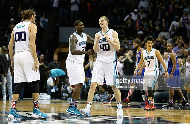 Cody Zeller celebrates with teammates Marvin Williams and Spencer Hawes of the Charlotte Hornets after hitting the game winning shot to defeat the...