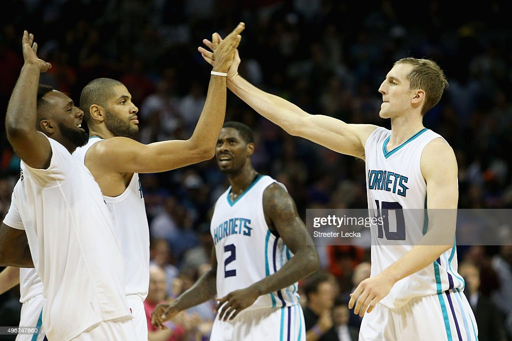 Cody Zeller #40 celebrates with teammates Nicolas Batum #5 and P.J. Hairston #19 of the Charlotte Hornets after hitting the game winning shot to defeat the New York Knicks 95-93 during their game at Time Warner Cable Arena on November 11, 2015 in Charlotte, North Carolina.