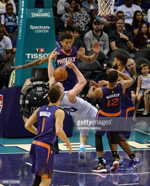 Cody Zeller of Charlotte Hornets falls backwards during the NBA match between Phoenix Suns vs Charlotte Hornets at the Spectrum arena in Charlotte NC...