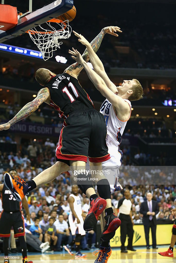 Cody Zeller #40 of the Charlotte Bobcats collides with Chris Andersen #11 of the Miami Heat in Game Four of the Eastern Conference Quarterfinals during the 2014 NBA Playoffs at Time Warner Cable Arena on April 28, 2014 in Charlotte, North Carolina.