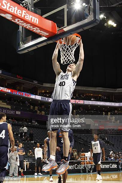 Cody Zeller of the Charlotte Bobcats dunks during the open practice at the Time Warner Cable Arena on October 23 2013 in Charlotte North Carolina...
