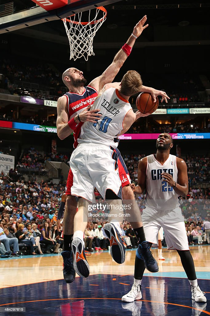 <a gi-track='captionPersonalityLinkClicked' href=/galleries/search?phrase=Cody+Zeller&family=editorial&specificpeople=7621233 ng-click='$event.stopPropagation()'>Cody Zeller</a> #40 of the Charlotte Bobcats goes up for a shot against the Washington Wizards at the Time Warner Cable Arena on March 31, 2014 in Charlotte, North Carolina.