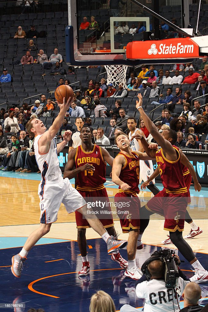 <a gi-track='captionPersonalityLinkClicked' href=/galleries/search?phrase=Cody+Zeller&family=editorial&specificpeople=7621233 ng-click='$event.stopPropagation()'>Cody Zeller</a> #40 of the Charlotte Bobcats shoots against <a gi-track='captionPersonalityLinkClicked' href=/galleries/search?phrase=Kenny+Kadji&family=editorial&specificpeople=5759678 ng-click='$event.stopPropagation()'>Kenny Kadji</a> #35 of the Cleveland Cavaliers during the game at the Time Warner Cable Arena on October 24, 2013 in Charlotte, North Carolina.