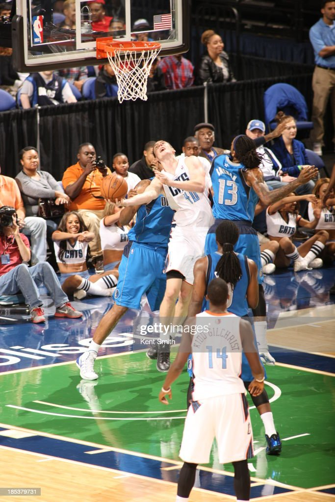 Cody Zeller #40 of the Charlotte Bobcats shoots against Renaldo Balkman #13 of the Dallas Mavericks at the Greensboro Coliseum on October 19, 2013 in Greensboro, North Carolina.