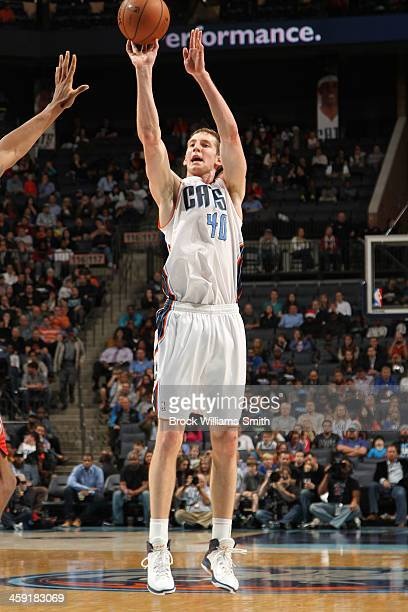 Cody Zeller of the Charlotte Bobcats shoots against the Milwaukee Bucks during the game at the Time Warner Cable Arena on December 23 2013 in...