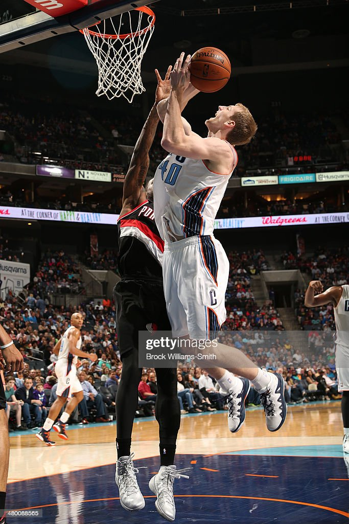 Cody Zeller #40 of the Charlotte Bobcats shoots against the Portland Trail Blazers at the Time Warner Cable Arena on March 22, 2014 in Charlotte, North Carolina.