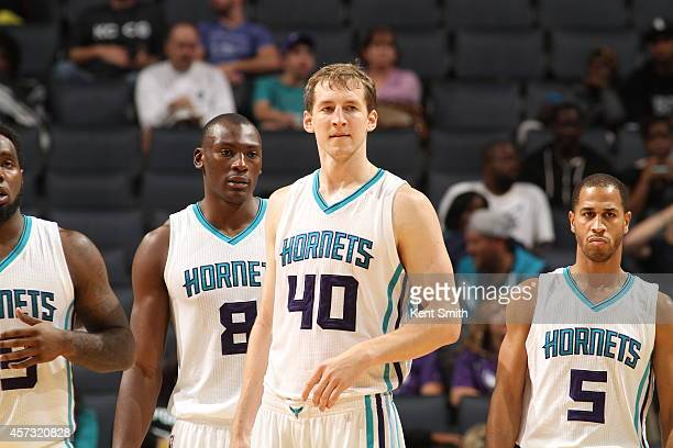 Cody Zeller of the Charlotte Hornets and his teammates look on during the game against the Orlando Magic at the Time Warner Cable Arena on October 13...