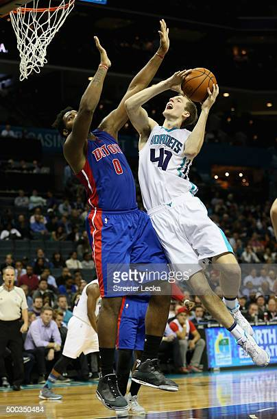 Cody Zeller of the Charlotte Hornets drives to the basket against Andre Drummond of the Detroit Pistons during their game at Time Warner Cable Arena...