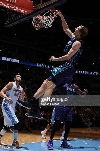 Cody Zeller of the Charlotte Hornets dunks against the Denver Nuggets during the game on January 31 2015 at the Pepsi Center in Denver Colorado NOTE...