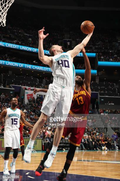 Cody Zeller of the Charlotte Hornets grabs the rebound during a game against the Cleveland Cavaliers on March 24 2017 at the Spectrum Center in...