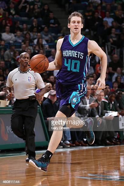 Cody Zeller of the Charlotte Hornets handles the ball against the Milwaukee Bucks on December 23 2014 at the BMO Harris Bradley Center in Milwaukee...