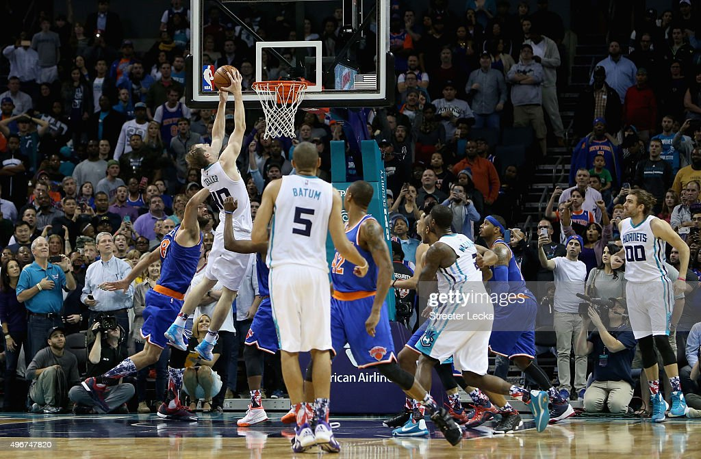 Cody Zeller #40 of the Charlotte Hornets hits the game winning shot to defeat the New York Knicks 95-93 during their game at Time Warner Cable Arena on November 11, 2015 in Charlotte, North Carolina.