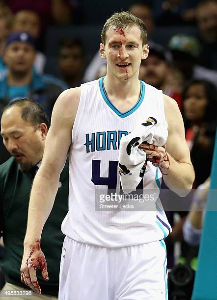 Cody Zeller of the Charlotte Hornets is hit in the face by Joakim Noah of the Chicago Bulls during their game at Time Warner Cable Arena on November...