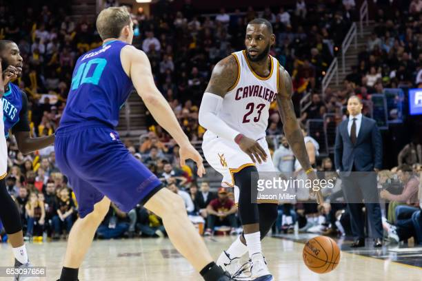 Cody Zeller of the Charlotte Hornets puts pressure on LeBron James of the Cleveland Cavaliers during the second half at Quicken Loans Arena on...