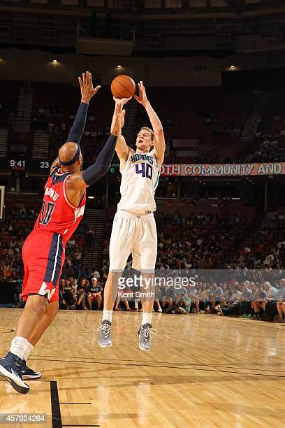 Cody Zeller of the Charlotte Hornets shoots against the Washington Wizards at Bon Secours Wellness Arena on October 10 2014 in Greenville South...