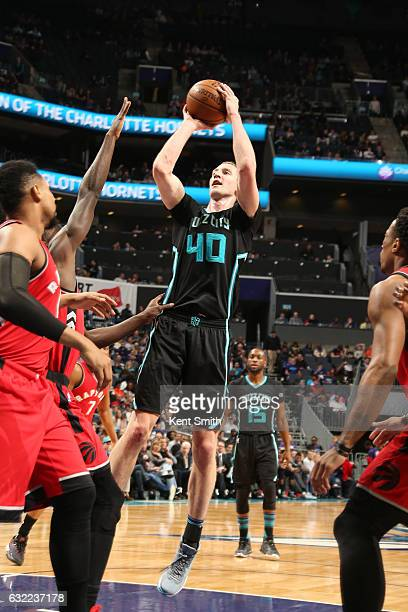Cody Zeller of the Charlotte Hornets shoots the ball against the Toronto Raptors on January 20 2017 at Spectrum Center in Charlotte North Carolina...