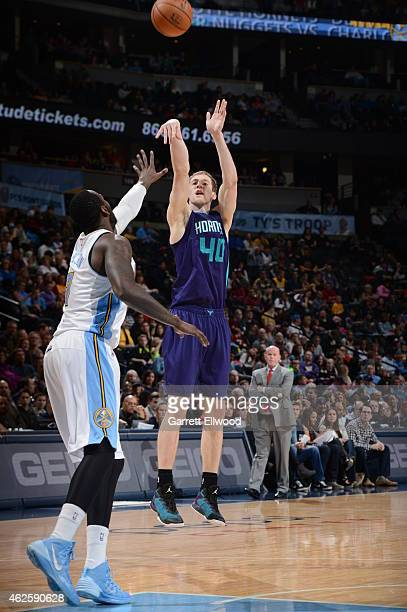 Cody Zeller of the Charlotte Hornets shoots the ball against the Denver Nuggets during the game on January 31 2015 at the Pepsi Center in Denver...