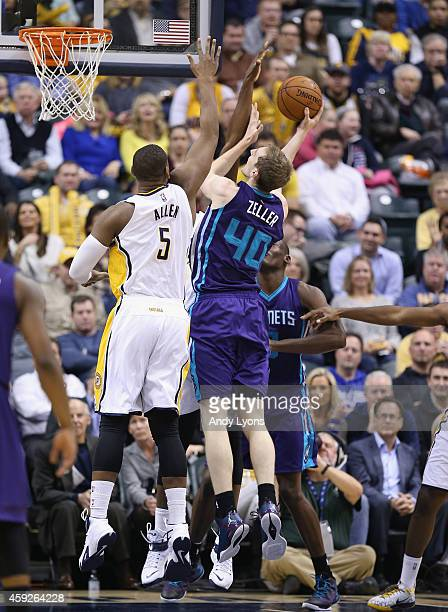 Cody Zeller of the Charlotte Hornets shoots the ball while defended by Lavoy Allen of the Indiana Pacers at Bankers Life Fieldhouse on November 19...