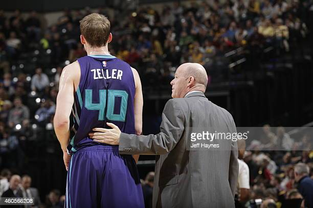 Cody Zeller of the Charlotte Hornets talks with Head coach Steve Clifford during the game against the Indiana Pacers at Bankers Life Fieldhouse on...
