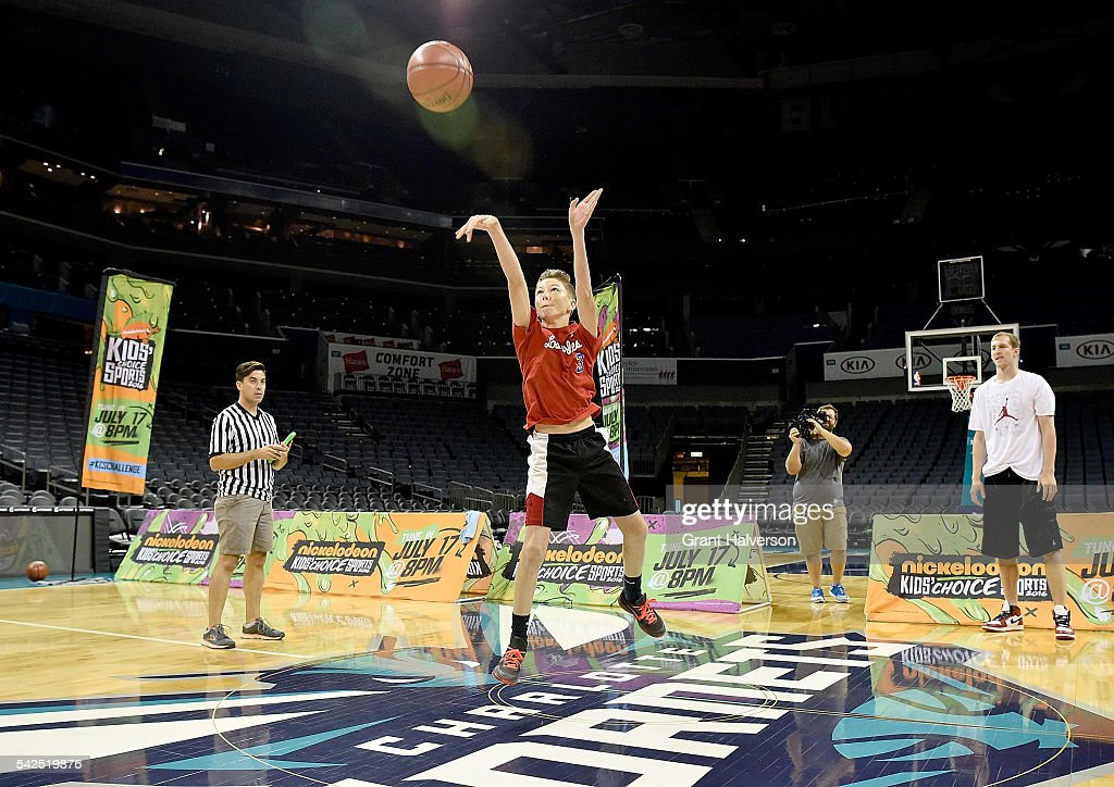 Cody Zeller of the Charlotte Hornets watches Camden Johnson make a halfcourt shot during tryouts for the 'Triple Shot Challenge: Kids' Choice Sports $50,000 Half-Court Shot' hosted by Nickelodeon and the Charlotte Hornets at Time Warner Cable Arena on June 23, 2016 in Charlotte, North Carolina.