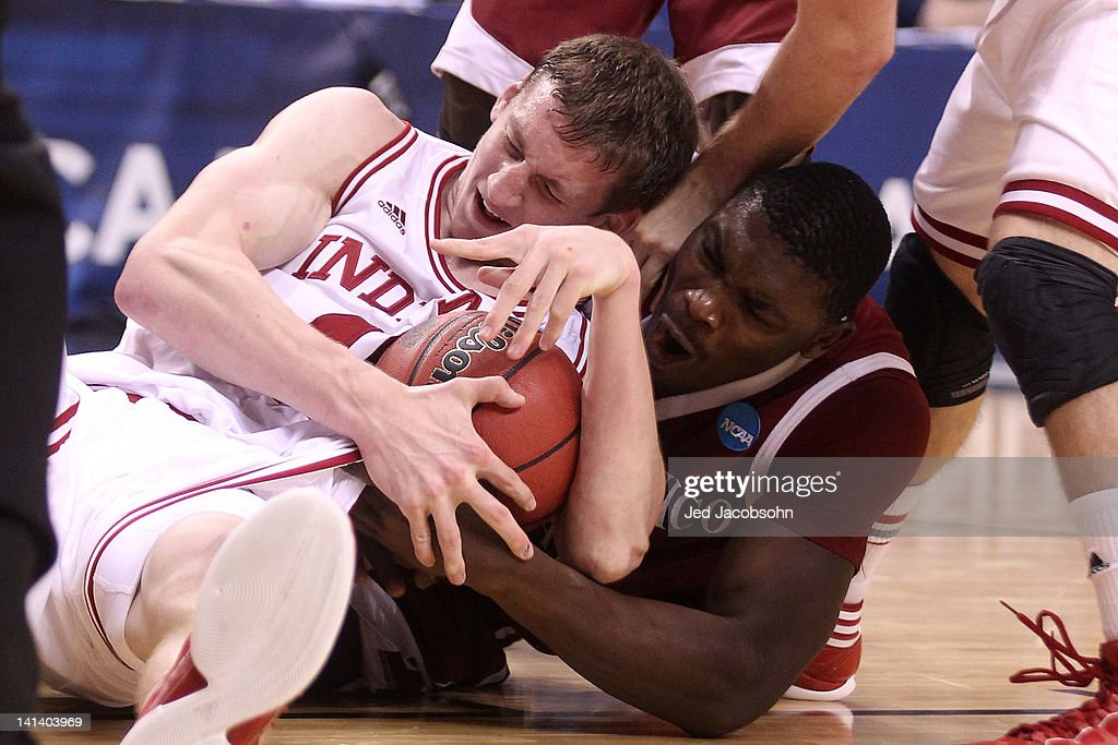 Cody Zeller #40 of the Indiana Hoosiers and Tshilidzi Nephawe #15 of the New Mexico State Aggies battle for a loose ball in the second half in the second round of the 2012 NCAA men's basketball tournament at Rose Garden Arena on March 15, 2012 in Portland, Oregon.