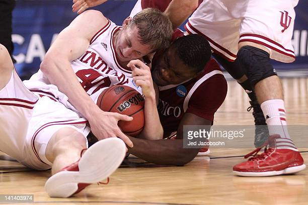 Cody Zeller of the Indiana Hoosiers and Tshilidzi Nephawe of the New Mexico State Aggies battle for a loose ball in the second half in the second...