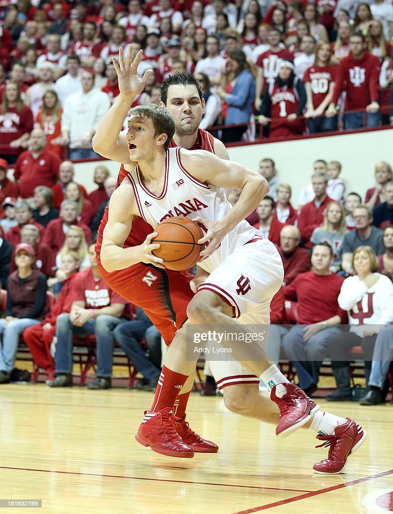 <a gi-track='captionPersonalityLinkClicked' href=/galleries/search?phrase=Cody+Zeller&family=editorial&specificpeople=7621233 ng-click='$event.stopPropagation()'>Cody Zeller</a> #40 of the Indiana Hoosiers dribbles the ball while defended by Andre Almeida #32 of the Nebraska Cornhuskers during the game at Assembly Hall on February 13, 2013 in Bloomington, Indiana.