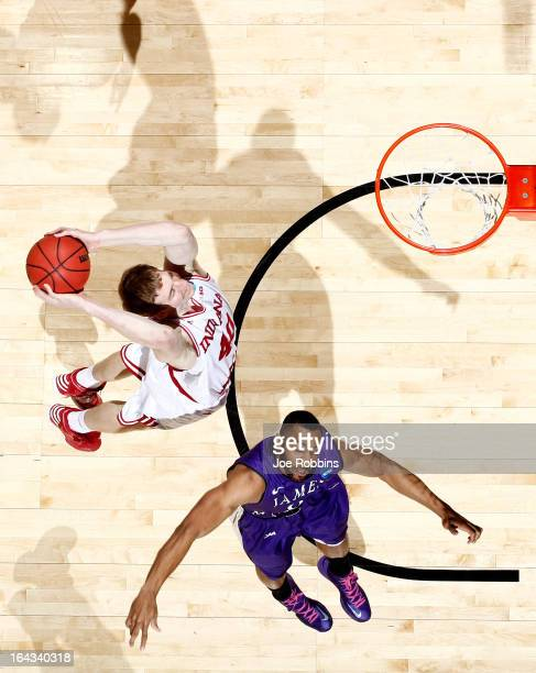 Cody Zeller of the Indiana Hoosiers goes up for a dunk against AJ Davis of the James Madison Dukes in the second half during the second round of the...