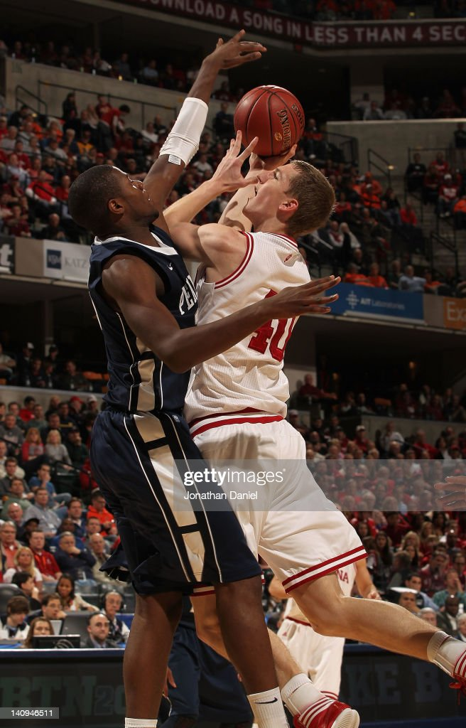 Cody Zeller #40 of the Indiana Hoosiers goes up for a shoot against Jon Graham #25 of the Penn State Nittany Lions during the first round of the Big Ten Basketball Tournament at Bankers Life Fieldhouse on March 8, 2012 in Indianapolis, Indiana. Indiana defeated Penn State 75-58.