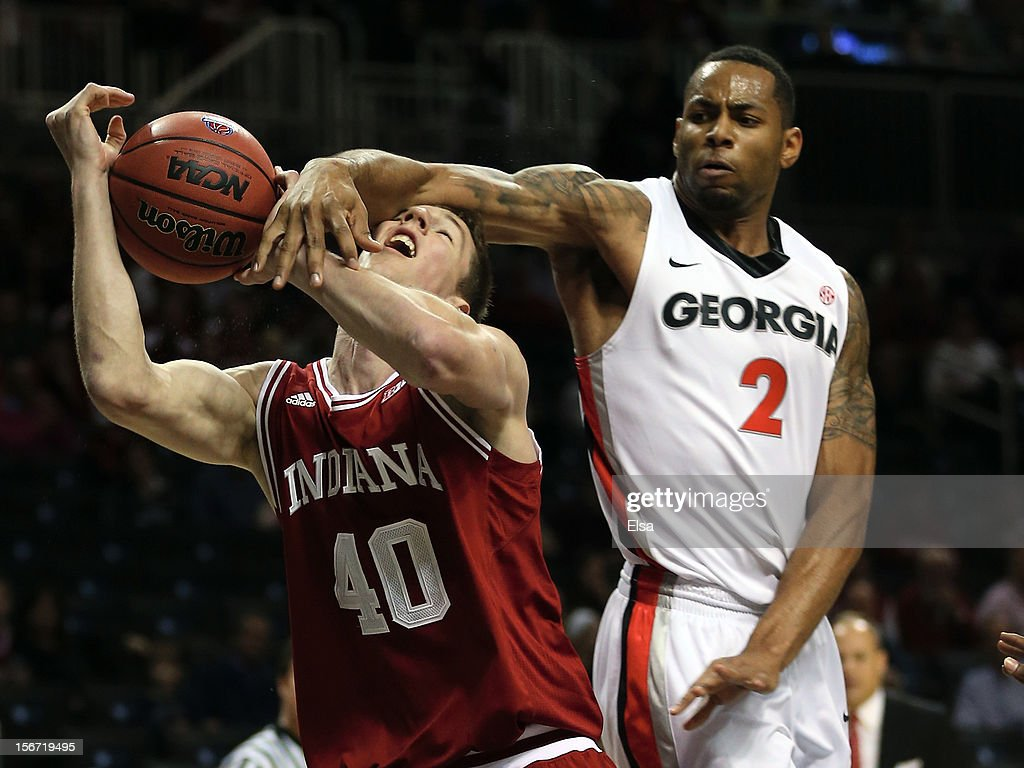 Cody Zeller #40 of the Indiana Hoosiers is fouled by Marcus Thornton #2 of the Georgia Bulldogs during the Legends Classic on November 19, 2012 at the Barclays Center in the Brooklyn borough of New York City.
