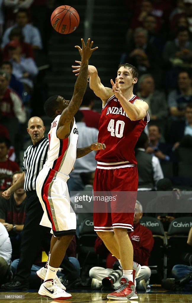Cody Zeller #40 of the Indiana Hoosiers passes the ball as Vincent Williams #11 of the Georgia Bulldogs defends during the Legends Classic on November 19, 2012 at the Barclays Center in the Brooklyn borough of New York City. The Indiana Hoosiers defeated the Georgia Bulldogs 66-53.
